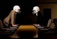 Businesswomen in face_off wearing football helmets