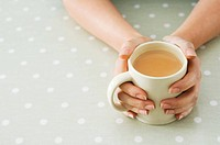 Person holding tea