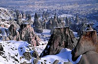 Fairy chimneys in the mist, Göreme valley. Cappadocia, Turkey