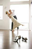 Couple in eveningwear dancing