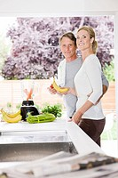 Portrait of couple preparing health shake in kitchen