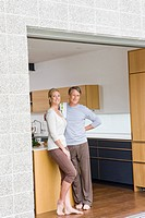 Portrait of couple standing in open patio doorway