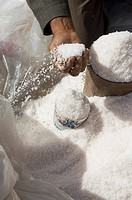 Man putting sea salt into containers