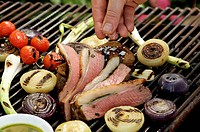Saddle of lamb on barbecue with sage pesto & grilled onions