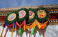 Buddhist banners with symbols and mantras such as the eight auspicious symbols and the Om Mani Padme Hum mantra
