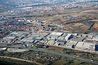 Spain, Catalonia, Barcelona, Barcelonés, la Llagosta industrial area (in foreground) and Ripollet (top left)