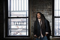 Portrait of a young man with dreadlocks