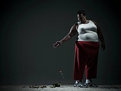 Overweight woman dropping salad
