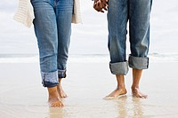 Legs of couple in the sea