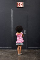 Rear view of a girl and a door