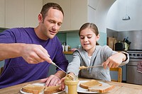 Father and daughter making sandwiches (thumbnail)