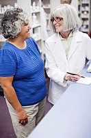 Pharmacist assisting customer (thumbnail)
