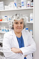 Portrait of smiling pharmacist with arms crossed