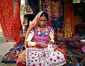 Woman doing embroidery, India, Asia