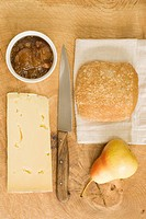 Cheddar cheese, apple chutney, bread and a pear