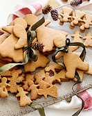 Various Sized Gingerbread Men and Women Cookies, Some Tied with Ribbon