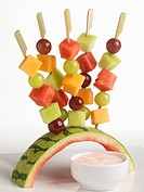 Fruit Skewers Stuck in Watermelon Rind Holder, Raspberry Yogurt Dip