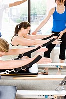 Women working out on pilates equipment