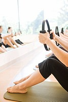 People in exercise class using resistance equipment