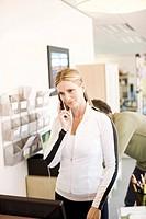 Woman in sportswear on telephone
