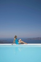 Woman in Infinity Pool, Fira, Santorini, Cyclades, Greek Islands, Greece, Europe
