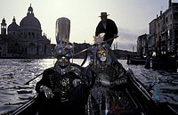 Masks in gondola on the Canale Grande Carnival in Venice Italy