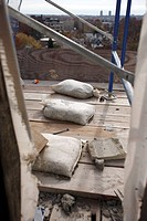 Sand bags on construction scaffolding