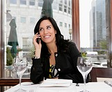 Businesswoman on mobile in restaurant