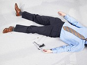 Man lying on floor with gun