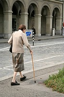 Old Woman walking down the street