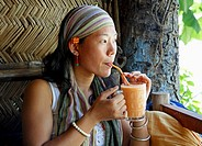 Chinese woman drinking juice