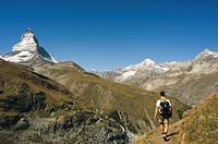 Hiker walking on trail near the Matterhorn, 4477m, Zermatt Alpine Resort, Valais, Switzerland, Europe