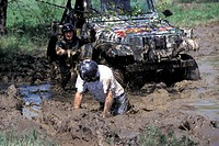 Man in mud at a rallye