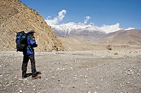 Trekker enjoys the view on the Annapurna circuit trek, between Jomsom and Muktinath, Himalayas, Nepal, Asia