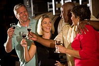Multicultural couples tasting wine on a winery tour