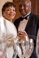 Close_up of mature African American couple dancing in formal attire