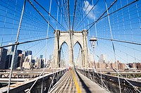 Pedestrian walkway on the Brooklyn Bridge looking towards Manhattan, New York City, New York, United States of America, North America