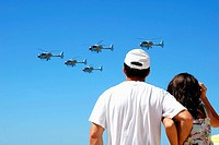 Father and daughter watching helicopters during an Air force Exhibition in Victoria beach, Cadiz, Spain, held on 23rd September 2008