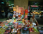 Elderly street trader with his stall in Bangkok, Thailand, Southeast Asia, Asia