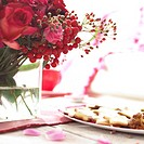 Red bouquet on decorated table (thumbnail)