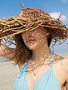 Woman with sun hat on the beach