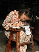 Girl doing homework, Yangtze River basin, China