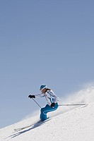 Woman skiing on mountainside