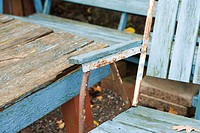 Dilapidated chair and table, close-up