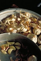 Fresh garlic being peeled and separated