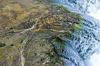Water flowing over rock, close-up (thumbnail)