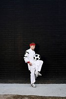 Boy wearing kimono with football
