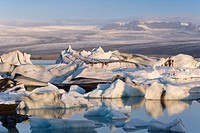 Icebergs floating in the Lagoon beneath Breidamerkurjokull Glacier, Jokulsarlon Glacial River Lagoon, southern Vatnajokull, southern area, Iceland, Po...