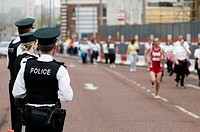 PSNI Officers watch runners in the Belfast Marathon