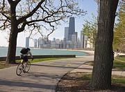 Cyclist by Lake Michigan shore, Gold Coast district, Chicago, Illinois, United States of America, North America